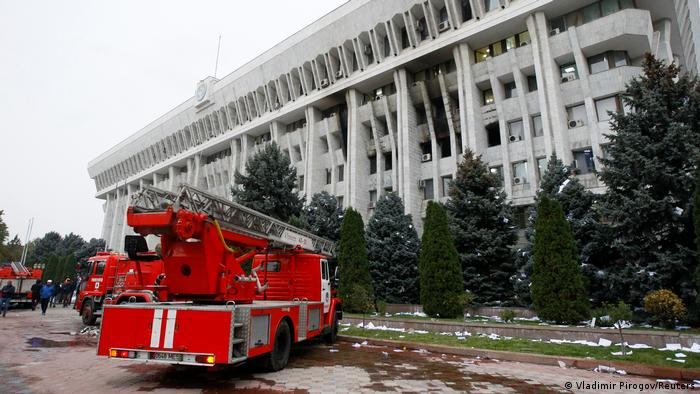 Fire brigade trucks are seen in front of the government headquarters which has been taken over by protesters against the results of a parliamentary election in Bishkek, Kyrgyzstan, October 6, 2020. (Vladimir Pirogov/Reuters)