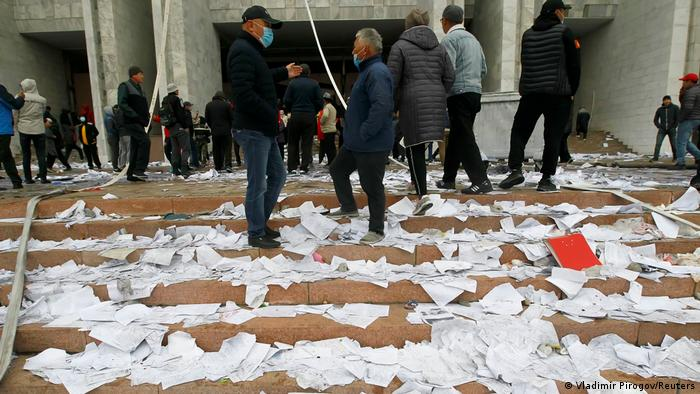 People protesting against the results of a parliamentary election stand in front of the government headquarters which has been taken over in Bishkek, Kyrgyzstan, October 6, 2020. (Vladimir Pirogov/Reuters)