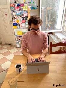 Elia Merguet working at his kitchen table in Berlin