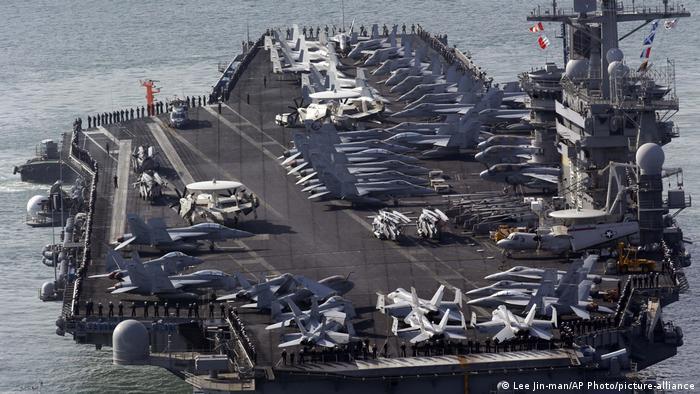 The USS Nimitz approaches Busan port in South Korea