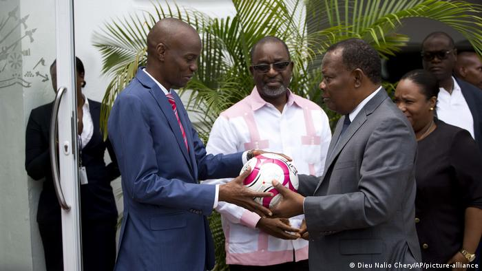 President Jovenel Moise being given a soccer ball by Jean-Bart