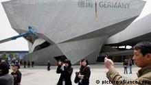 Visitors take snaps in front of the Germany Pavilion at the site of the 2010 World Expo in Shanghai, China on 24 April 2010. The Expo organizers have received feedback from some 200,000 people who visited the venue during the trial run in the last days. An estimated 70 million people from around the world are expected at the six-month event, which opens on 01 May 2010. EPA/QILAI SHEN +++(c) dpa - Bildfunk+++