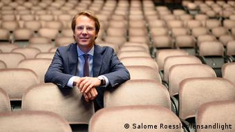 Markus Fein sits in an empty field of seats