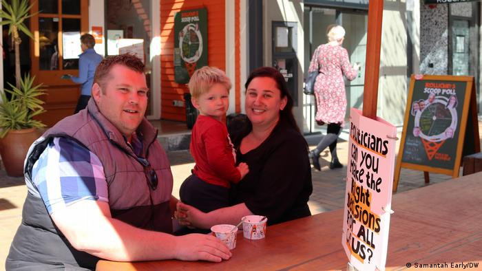 A family eating an ice cream at a cafe in Christchurch
