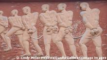 A close-up of an artwork depicting victims of the transatlanic slave trade shackled together