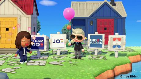Still of video game Animal Crossing, where two cartoon characters representing Kamala Harris and Joe Biden stand in front of houses ( Joe Biden campaign )