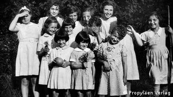 A black-and-white group photo of young girls smiling