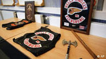 Two axes and a leather jacket with a 'Hell's Angels Flensburg' logo