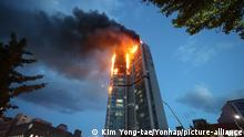 An apartment building is engulfed in a fire in Ulsan, South Korea, Friday, Oct. 9, 2020. A fire spread through the high-rise apartment building in the port city early Friday, causing minor injuries to scores of people, officials said. (Kim Yong-tae/Yonhap via AP) |