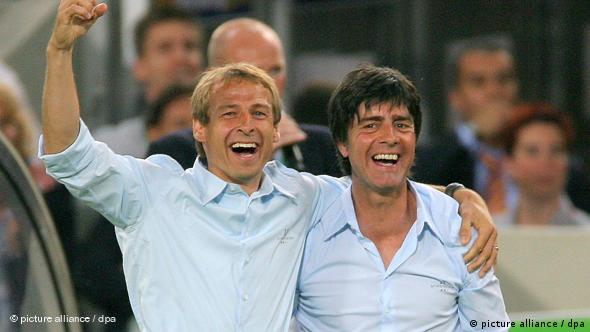 German head coach Juergen Klinsmann and his assistant Joachim Loew celebrate together at World Cup 2006
