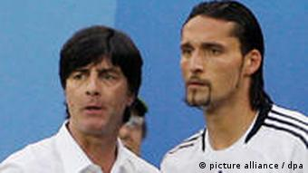 Joachim Loew giving Kevin Kuranyi advice before the striker comes on for Germany