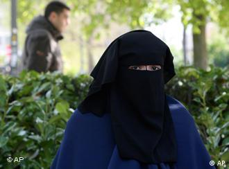 A fully veiled Moslem woman in a Brussels park