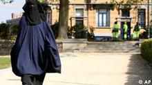 FILE - In this April 22, 2010 file photo, Selma, a 22 year old woman, wears the niqab as she walks in a park in Brussels. The Belgian parliament is likely to vote Thursday, April 29, 2010 on whether to ban face coverings worn by observant Muslim women. If passed, the ban would make Belgium the first country in Europe to outlaw the face coverings, which include both niqabs and burqas. (AP Photo/Yves Logghe, File)