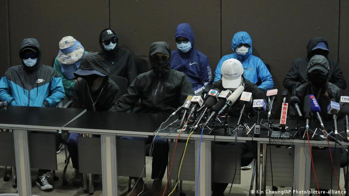 In this Saturday, Sept. 12, 2020 photo, relatives of 12 Hong Kong activists detained at sea by Chinese authorities attend a press conference in Hong Kong.