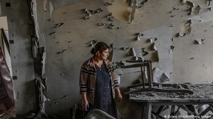 Woman inside destroyed flat, Azerbaijan