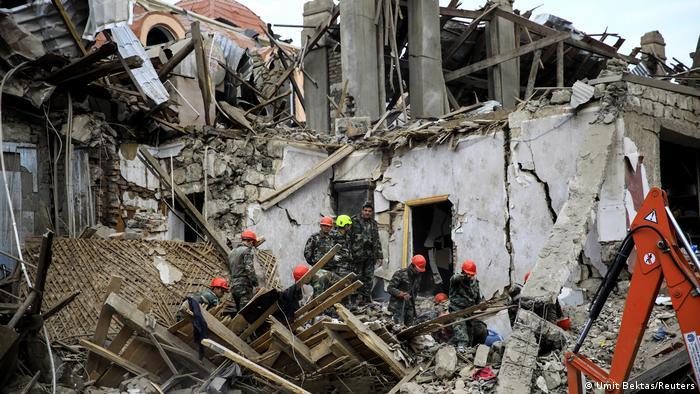 Buildings left in ruins by rocket strike (Umit Bektas/Reuters)