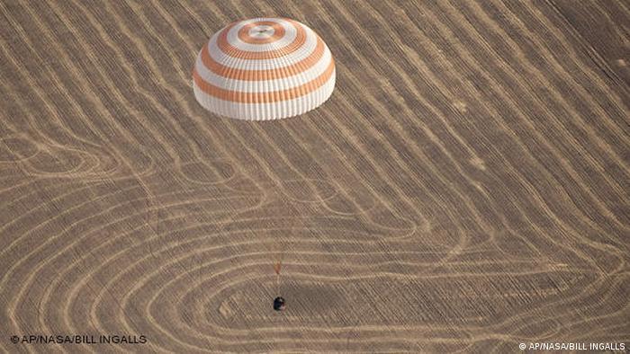 A Soyuz capsule lands in Kazakhstan with space tourist Guy Laliberté onboard