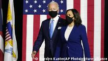 Joe Biden and Kamala Harris arrive to speak at a news conference in Wilmington