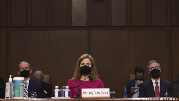 Amy Coney Barrett, masked, at the hearing.