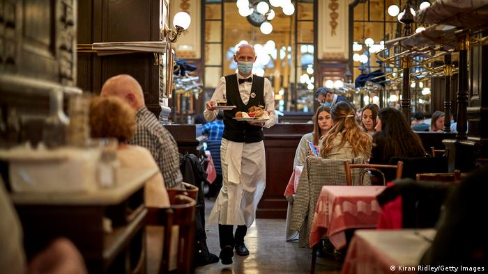 A chef serving customers in Paris (Kiran Ridley/Getty Images)