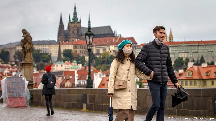 A woman and a man about in Prague (Gabriel Kuchta/Getty Images)
