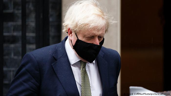 British Prime Minister Boris Johnson wears a face mask as he leaves 10 Downing Street headed for the Houses of Parliament in London, England, on October 12, 2020.