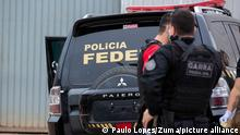 July 25, 2019, Sao Paulo, Sao Paulo, Brazil: Police inspect the vehicles that were left by suspects involved in heist carried out at Sao Paulo's Guarulhos International Airport. Authorities say eight armed men raided a terminal and escaped with some 750 kilos (750,000 grams) of precious metals. The airport operator said that the thieves bypassed security systems by using two cars that looked like federal police vehicles. (Credit Image: © Paulo Lopes/ZUMA Wire |