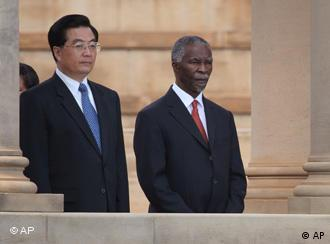 South African President Thabo Mbeki, right, and his Chinese counterpart, Hu Jintao, left, stand during a welcoming ceremony in Pretoria, South Africa, Tuesday, Feb. 6, 2007. Hu is on a state visit to South Africa as part of his African tour. (AP Photo/Denis Farrell)