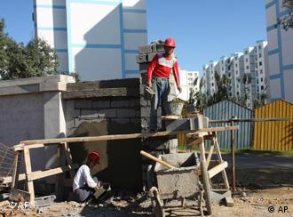Chinese workers building a wall at a housing project funded by the Algerian government and built by a state-owned Chinese firm near Algiers, Algeria.