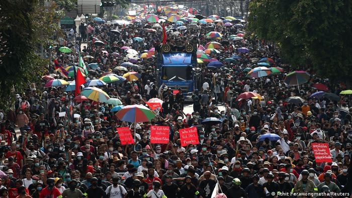 Anti-government protesters fill a road in central Thailand