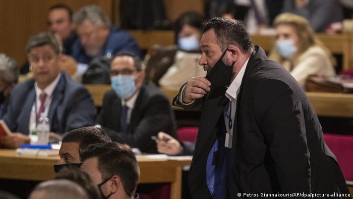 Ioannis Lagos speaks in a court room