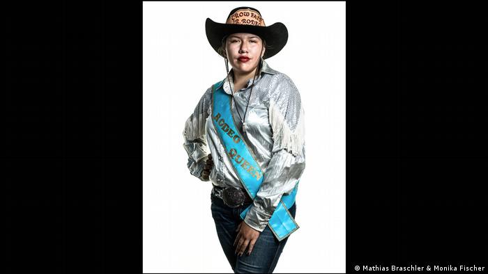 A woman with cowboy hat, and a 'Rodeo Queen' sash - a photo from the book Divided We Stand' by Mathias Braschler and Monika Fischer (Mathias Braschler & Monika Fischer)