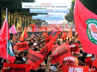 Albanian opposition supporters hold banners during a demonstration, in Tirana