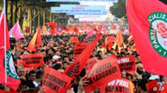 Albanian opposition supporters hold banners during a demonstration, in Tirana, Albania, Friday, April 30, 2010.