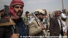 Tribesmen loyal to Houthi rebels hold their weapons as they attend a gathering against the agreement