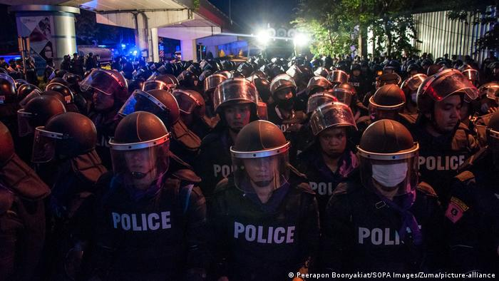 A crowd of police in riot gear