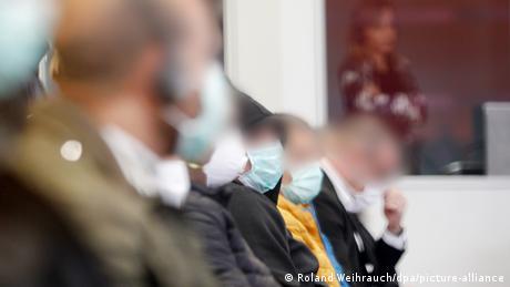 All defendants in Düsseldorf trial wearing anti-coronavirus masks