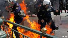 Greek riot police are set on fire by protesters throwing petrol bombs in Athens on Saturday May 1, 2010. Tens of thousands of protesters gathered in central Athens and other Greek cities Saturday for May Day rallies fueled by anger at expected harsh austerity measures needed to secure rescue loans for near-bankrupt Greece. (AP Photo/Evi Zoupanou)