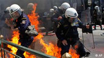 Greek riot police are set on fire by protesters throwing petrol bombs in Athens