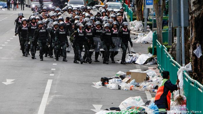 A group of police patrol the streets