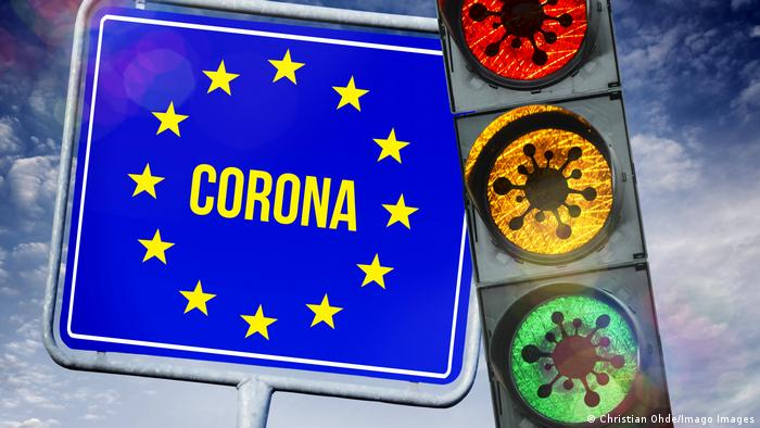 Montage of an EU sign reading Corona and a traffic light with virus illustrations