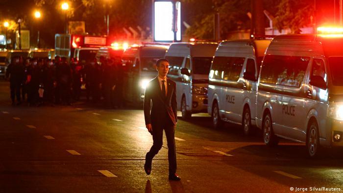 A man walks down a street