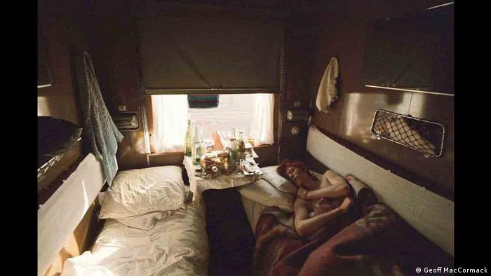 David Bowie sleeps in a carriage of the Trans-Siberian Express to Moscow in this photo taken in 1973 (Geoff MacCormack)