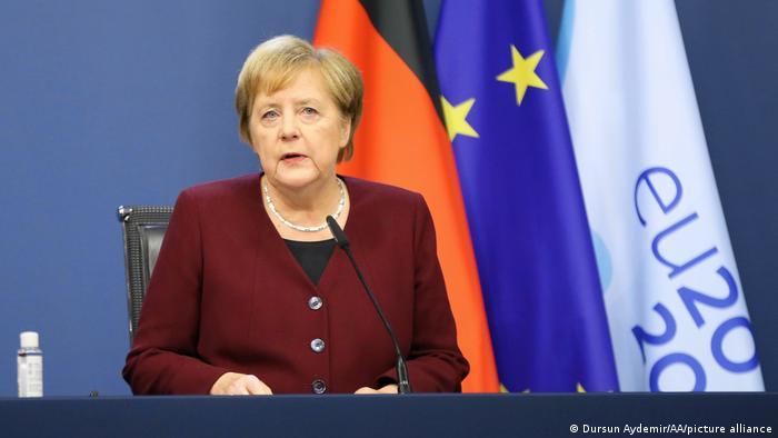 Merkel addresses a press conference in Brussels