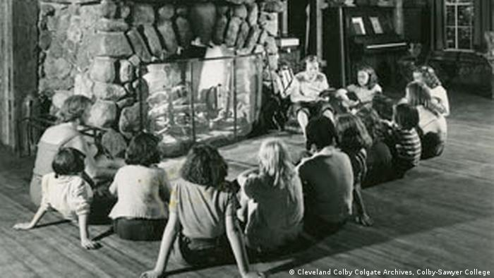 Colbytown campers sit in front of a fireplace