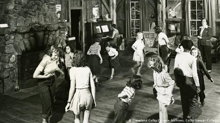 Colbytown campers dance in front of a fireplace at Colbytown Camp