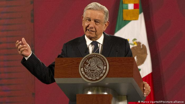 Mexican President Lopez Obrador speaking at a podium