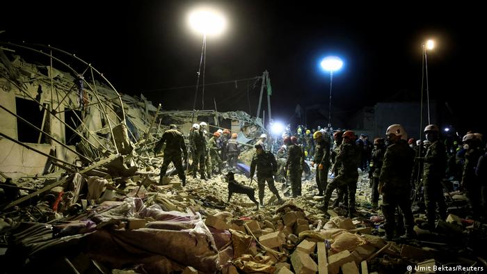 Rescue teams pick through rubble on Saturday in the city of Ganja, Azerbaijan