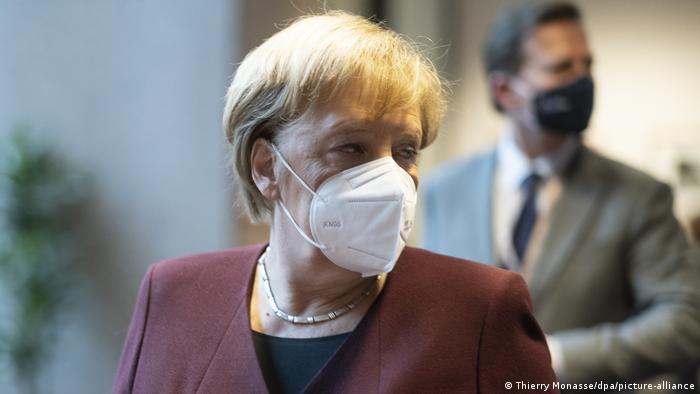 German Chancellor Angela Merkel wearing a white face mask