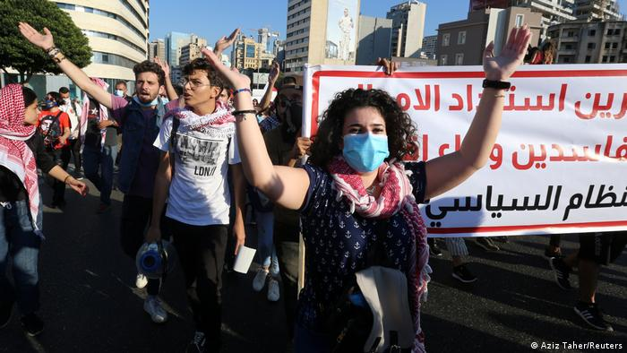 People carrying banners march during nationwide anti-government protests in October, 2020